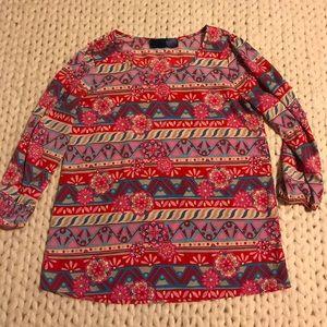 Francesca's colorful blouse